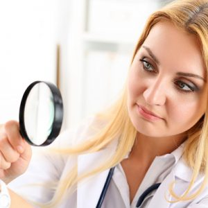 dermatologist inspecting skin