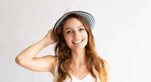 smiling young woman wearing a hat