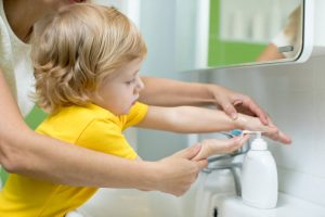helping child wash hands