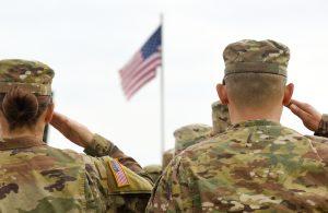 US troops saluting flag