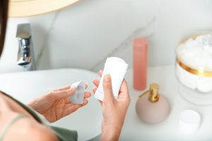 woman holding an antiperspirant