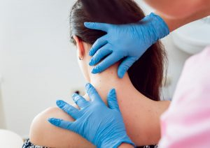 dermatologist examining patient