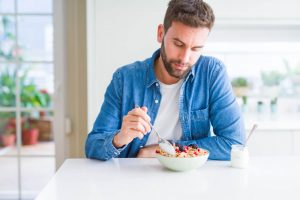man eating his breakfast