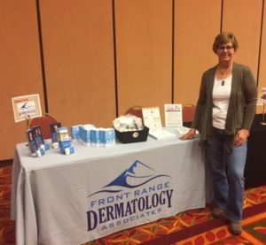 Michele at the Front Range Dermatology table