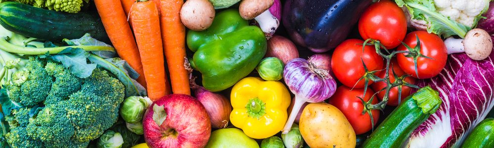 assortment of vegetables such as yellow papers, broccoli, and tomatoes for healthy skin